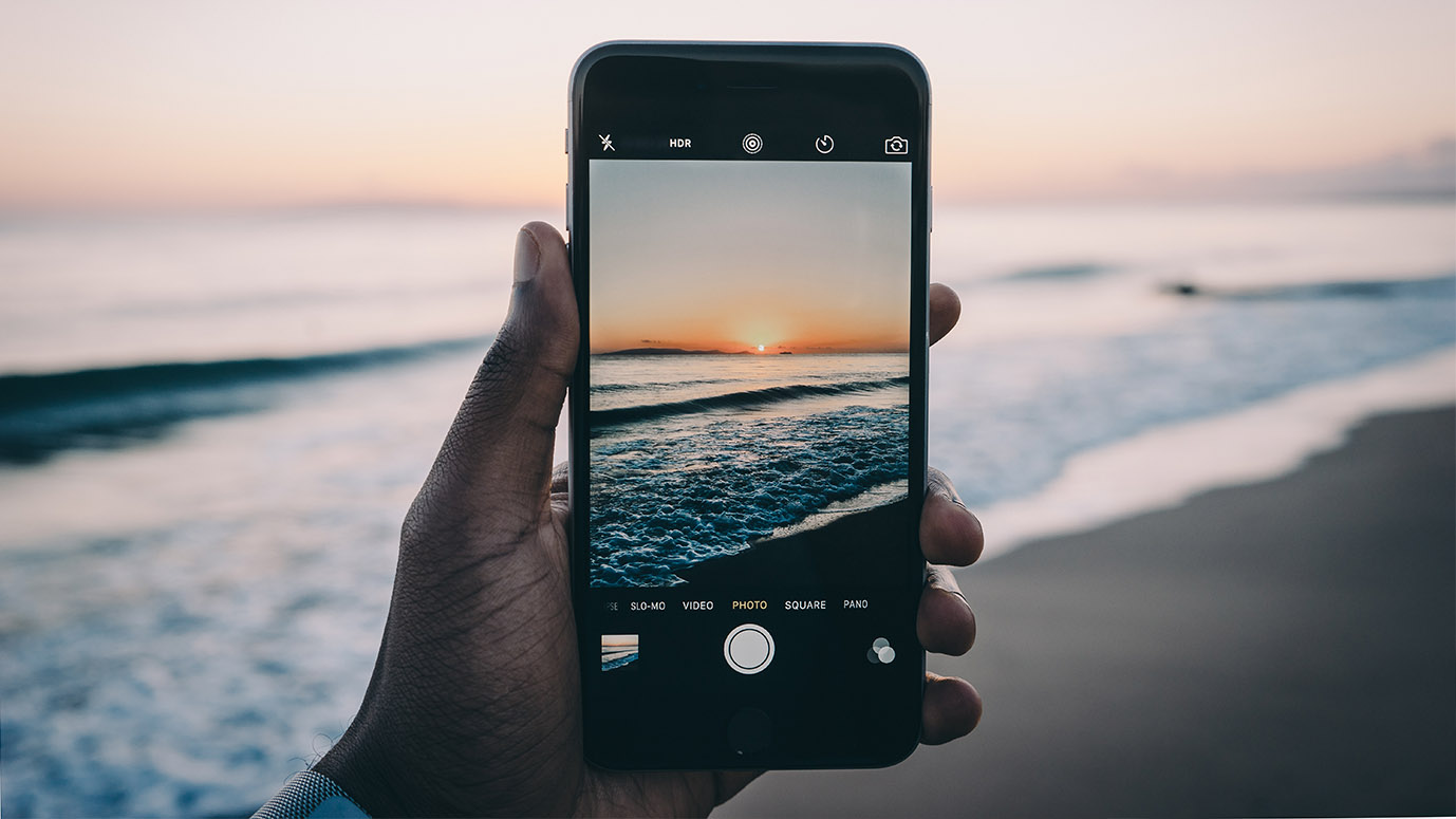 With the phone on the beach